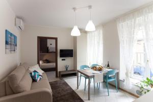 AcquaTerraFuoco - City apartments - AbcAlberghi.com