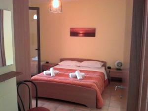 Oasi, Отели типа «постель и завтрак» - Порто-Чезарео