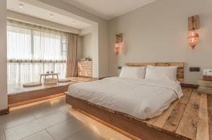 Zen Tea House Seven Stars Park, Bed & Breakfast  Guilin - big - 60