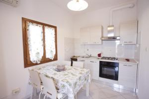 Appartamento Le Conchiglie - AbcAlberghi.com