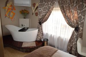 Kiwara Guesthouse, Penzióny  Johannesburg - big - 6