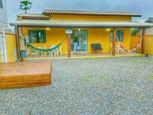 Casa Ipê Roxo - Canto Grande