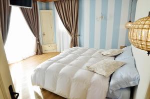 B&B Chalet, Отели типа «постель и завтрак»  Азиаго - big - 37