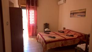 B&B Neverland, Bed and Breakfasts  Marrùbiu - big - 2