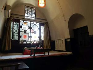 Pingyao Ancient City Zhengxin Caotang Inn, Penzióny  Pingyao - big - 24