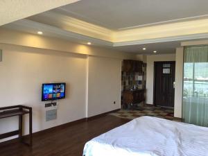 Zunke Zhuagnyuan Yuhai Apartment, Appartamenti  Dongshan - big - 5