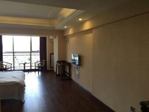 Zunke Zhuagnyuan Yuhai Apartment, Appartamenti  Dongshan - big - 6