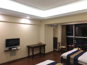 Zunke Zhuagnyuan Yuhai Apartment, Appartamenti  Dongshan - big - 7