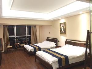 Zunke Zhuagnyuan Yuhai Apartment, Appartamenti  Dongshan - big - 9