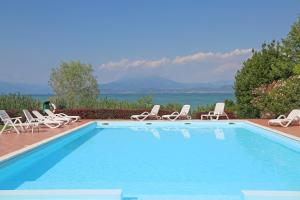 Appartamento FRONTE LAGO CORONA - AbcAlberghi.com