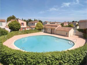 obrázek - Three-Bedroom Holiday Home in Aigues-Mortes