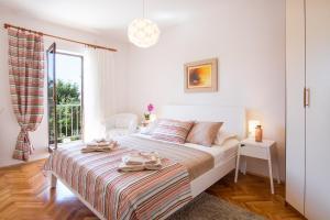 4-Bedroom Apartment in Malinska/Insel Krk 13139, Апартаменты  Малинска - big - 19