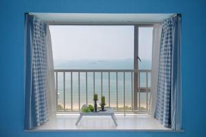obrázek - Sanya Xin Ya Ju Holiday Apartment