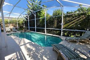 Four-Bedroom Audez Tropical Villa, Виллы  Орландо - big - 34