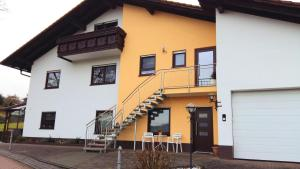 WHG Schmitt - Ferienwohnung - Bullau