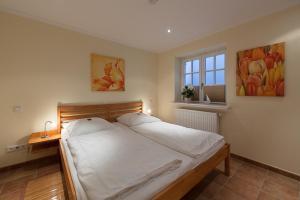 Landhaus Normannenweg App 1, Appartamenti  Wenningstedt - big - 12