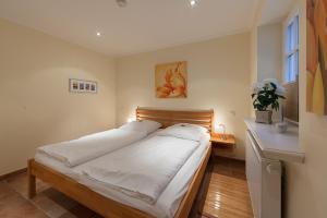 Landhaus Normannenweg App 1, Appartamenti  Wenningstedt - big - 13