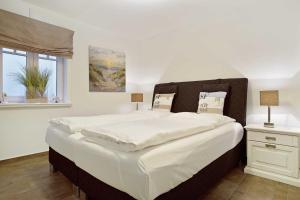 Landhaus Berthin Bleeg Buhne 4, Appartamenti  Wenningstedt - big - 10
