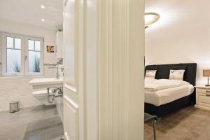Landhaus Berthin Bleeg Buhne 4, Appartamenti  Wenningstedt - big - 18
