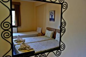 Roula Rooms, Апартаменты  Стратонион - big - 4