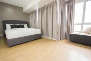 Oasis Regency @ Fort Victoria BGC, Апартаменты  Манила - big - 102