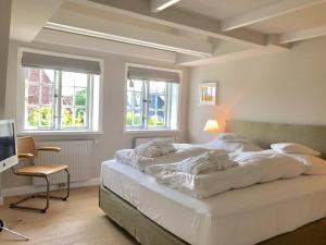 Kleiner Ulenhof, Appartamenti  Wenningstedt - big - 40