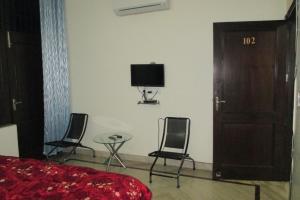 Room in a homestay in DLF Ph. 4, Gurgaon, by GuestHouser 12140, Dovolenkové domy  Gurugram - big - 11