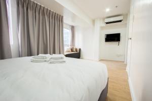 Oasis Regency @ Fort Victoria BGC, Апартаменты  Манила - big - 101