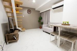 Oasis Regency @ Fort Victoria BGC, Апартаменты  Манила - big - 67
