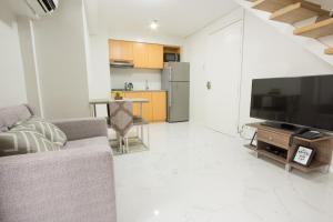 Oasis Regency @ Fort Victoria BGC, Апартаменты  Манила - big - 64