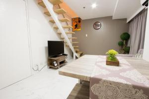Oasis Regency @ Fort Victoria BGC, Апартаменты  Манила - big - 131