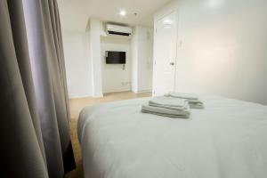 Oasis Regency @ Fort Victoria BGC, Апартаменты  Манила - big - 129