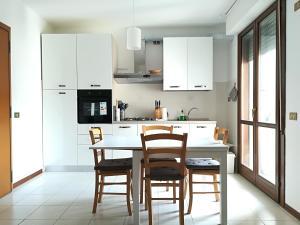 Appartamento Luminoso - AbcAlberghi.com