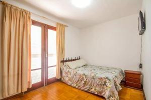 Casa Bem Pertinho do Capivari, Dovolenkové domy  Campos do Jordão - big - 6