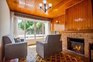 Casa Bem Pertinho do Capivari, Dovolenkové domy  Campos do Jordão - big - 2