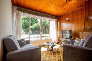 Casa Bem Pertinho do Capivari, Dovolenkové domy  Campos do Jordão - big - 4