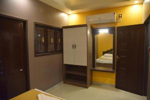 Subra Residency, Апарт-отели  Кумбаконам - big - 29