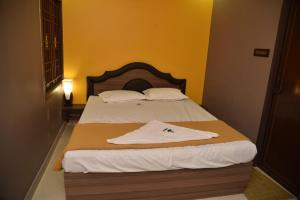 Subra Residency, Апарт-отели  Кумбаконам - big - 25
