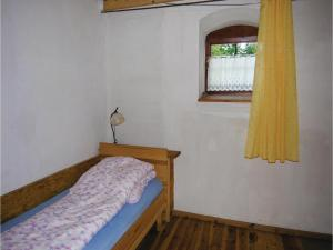Four-Bedroom Holiday Home in Orzysz