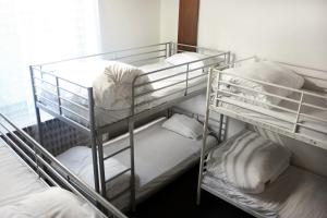 Bed in 6-Bed Mixed Dormitory Room Adipusaka Homestay