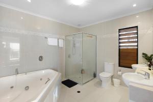Whitsunday Ocean Melody Deluxe Villa, Alloggi in famiglia  Airlie Beach - big - 10