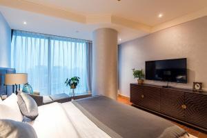 Gelade Service Apartment, Appartamenti  Chengdu - big - 43
