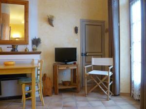 Studio dans maison de village