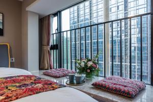 Beiou Duplex Two Bedroom Apartment, Ferienwohnungen  Guangzhou - big - 3