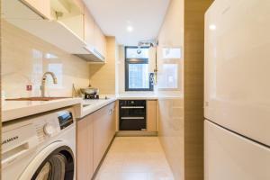 Beiou Duplex Two Bedroom Apartment, Ferienwohnungen  Guangzhou - big - 11