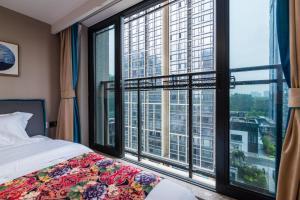 Beiou Duplex Two Bedroom Apartment, Ferienwohnungen  Guangzhou - big - 14
