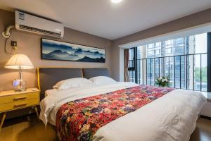 Beiou Duplex Two Bedroom Apartment, Ferienwohnungen  Guangzhou - big - 17