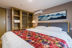 Beiou Duplex Two Bedroom Apartment, Ferienwohnungen  Guangzhou - big - 21