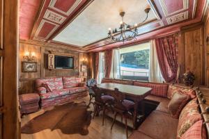 Appartamento M. di Campiglio su Piste - AbcAlberghi.com