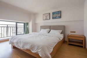 Queen Apartment Puwu Three Bedrooms Loft, Апартаменты  Сямынь - big - 22